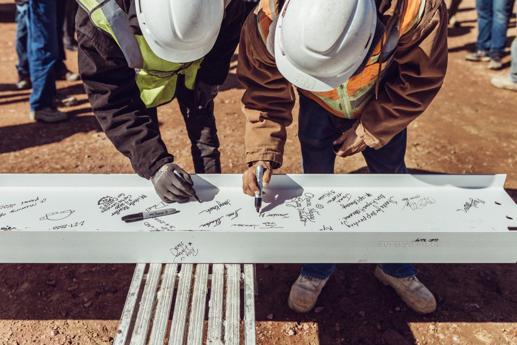 Construction topping out beam signing